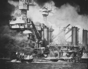 In this US Navy file photo, a small boat rescues a USS West Virginia crew member from the water after the Japanese bombing of Pearl Harbor, Hawaii on Dec. 7, 1941 during World War II.