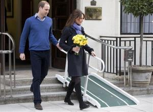 Prince William and Kate leave the King Edward VII hospital in central London on Thursday.
