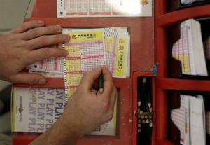 A Powerball player picks his numbers in this file photo.