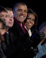 President Barack Obama and first Lady Michelle Obama look to the stage during the National Christmas Tree Lighting on the Ellipse, Thursday, Dec. 6, 2012, in Washington.