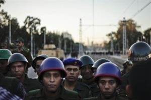 Egyptian army soldiers stand guard during a demonstration in front of the presidential palace in Cairo, Egypt, Friday, Dec. 7, 2012.