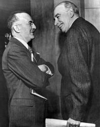 Harry White, left, talks to John Maynard Keynes in Savannah, Ga., March 8, 1946.