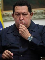 Venezuela's President Hugo Chavez kisses a crucifix during a speech last night in which he said that his cancer had returned and that he would again seek treatment in Cuba.