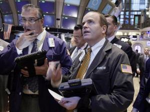 Traders work on the floor of the New York Stock Exchange Wednesday, Jan. 18, 2012.