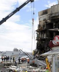 In this Thursday, Feb. 24, 2011 photo, search and rescue personnel work at the destroyed CTV building in Christchurch.