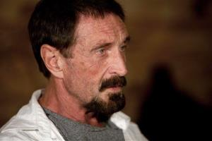 In this Dec. 4, 2012, file photo, software company founder John McAfee listens to a question during an interview at a local restaurant in Guatemala City.