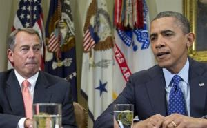 This Nov. 16, 2012 file photo shows President Obama, accompanied by John Boehner, speaking to reporters in the Roosevelt Room of the White House in Washington.