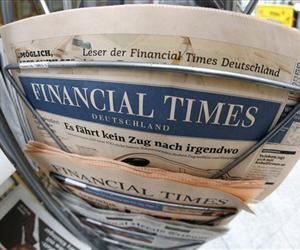 An edition of the Financial Times Deutschland is seen at a newspaper and tobacco shop in Frankfurt, Germany, Nov. 23, 2012.  The German edition ceased publication last week.