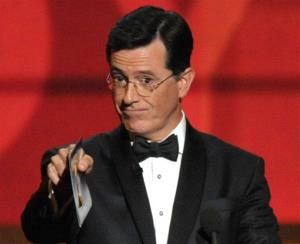 In this Sept. 23, 2012 file photo, Stephen Colbert presents an award onstage at the 64th Primetime Emmy Awards at the Nokia Theatre in Los Angeles.