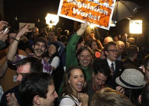 In this Nov. 6, 2012 file photo, people attending an Amendment 64 watch party celebrate after a local television station announced the marijuana amendment's passage in Denver.