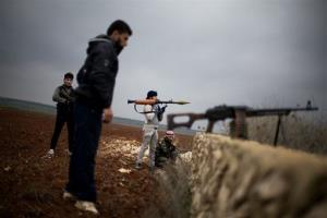 Free Syrian Army fighters take their positions close to a military base near Azaz, Syria, yesterday.