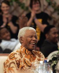 Nelson Mandela reacts as  Zambia's former President Kenneth Kaunda, unseen, makes a joke during his 90th birthday celebrations at his house in Qunu, South Africa, Saturday, July 19, 2008.