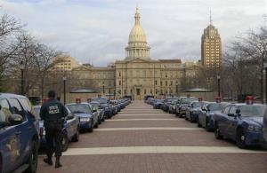 Michigan State Police cruisers line the pedestrian walkway west of the state Capitol in Lansing, Mich., Monday, Dec. 10, 2012.