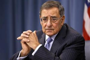 Leon Panetta listens during a news conference at the Pentagon in Washington.
