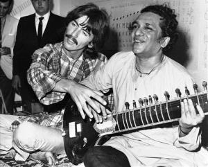 In this Aug. 3, 1967 photo, George Harrisonsits cross-legged with his musical mentor, Ravi Shankar, in Los Angeles.