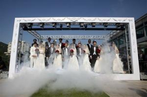 Twelve couples attend a mass wedding ceremony at the Peak in Hong Kong, Wednesday, Dec. 12, 2012.