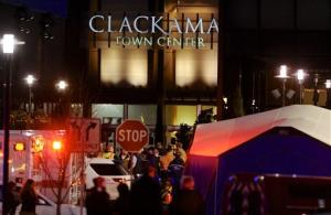 Police and medics work the scene of a multiple shooting at Clackamas Town Center Mall in Portland, Ore.
