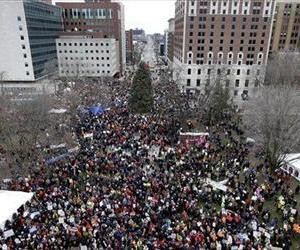 Protesters gather for a rally outside the State Capitol in Lansing, Mich., Dec. 11, 2012.