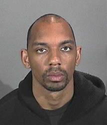 This 2009 photo from the Hermosa Beach, Calif., Police Department shows Brandon Lincoln Woodard.