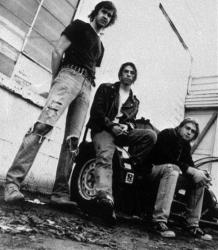 Members of the band Nirvana shown in a 1991 file photo are (from left) Krist Novoselic, David Grohl, and Kurt Cobain.