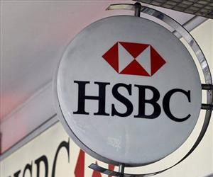 This is a Monday, Feb. 27, 2012 file photo of  the logo is seen on a branch of HSBC bank in London.