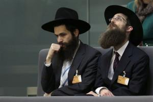 Orthodox Jews attend a meeting of the German Federal Parliament, or Bundestag, in Berlin Wednesday.