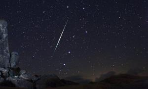 A Geminid fireball explodes over the Mojave Desert in the Jojave Desert, Calif., on Dec. 13, 2009.