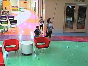 FILE - In this file hospital surveillance photo released by the Phoenix Police Department on Monday, Dec. 3, 2012, Norma Bracamontes walks with her 11-year-old daughter, Emily, rear, a leukemia patient who had her arm amputated and a heart catheter inserted due to an infection, and another child at Phoenix...