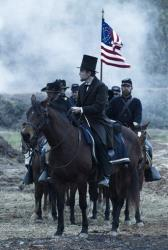 This undated publicity photo provided by DreamWorks and Twentieth Century Fox shows Daniel Day-Lewis as President Abraham Lincoln in this scene from director Steven Spielberg's drama Lincoln.