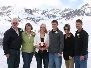 Track Palin and his bride Britta Hanson pose with her parents, Duane and Elizabeth Hanson, left, and his parents, Sarah and Todd Palin, right, after their wedding ceremony in Hatcher Pass, Alaska.