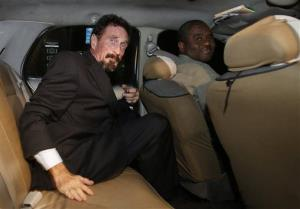 Anti-virus software founder John McAfee sits in a taxi cab in the South Beach area of Miami Beach, Fla., on his way to dinner Wednesday, Dec 12, 2012.