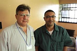 This Wednesday, Aug. 1, 2012 photo provided by attorney Peter Cross shows Cross, left, posing while on a visit with his client Eric Glisson at New York's Sing Sing prison.