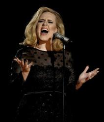This Feb. 12, 2012 file photo shows Adele performing during the 54th annual Grammy Awards in Los Angeles.