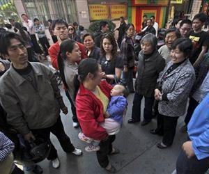 People gather outside the Zhongxin Kindergarten in China's Jiangsu Province, after a similar knife attack back in May 2010 in this file photo.