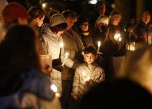 Mourners gather for a candlelight vigil at Ram's Pasture to remember shooting victims, Saturday, Dec. 15, 2012 in Newtown, Conn.