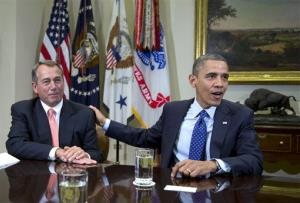 In this Nov. 16, 2012, file photo, President Barack Obama acknowledges House Speaker John Boehner of Ohio while speaking to reporters in the Roosevelt Room of the White House in Washington.