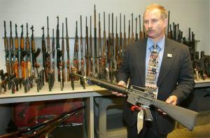 In this Monday June 16, 2003, file photo, an ATF examiner displays a Bushmaster .223 caliber rifle in the ATF gun vault in Beltsville, Md.