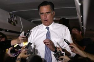 Mitt Romney speaks to reporters en route from Pittsburgh to Boston, Tuesday, Nov. 6, 2012.