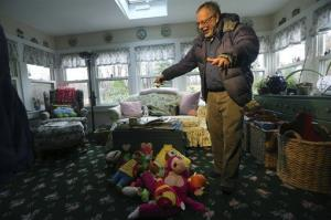 Gene Rosen shows some of the stuffed animals he entertained the children with in Newtown, Conn.