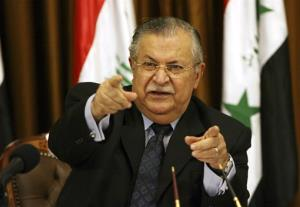 Jalal Talabani talks to reporters in Baghdad, Iraq. The office of Iraqi President Jalal Talabani said Tuesday he has been admitted to the hospital for treatment of an unspecified health problem..