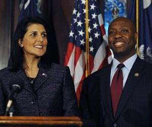 Nikki Haley announces Tim Scott, right, as Jim DeMint's replacement in the US Senate during a news conference at the South Carolina Statehouse, Dec. 17, 2012.