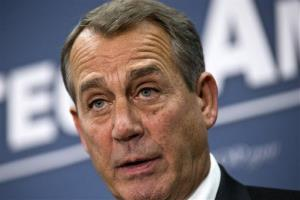 John Boehner speaks to reporters about the fiscal cliff negotiations with President Obama following a closed-door strategy session at the Capitol Tuesday.