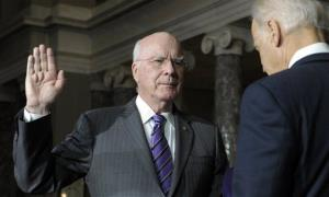 Vice President Joe Biden, right, reenacts the swearing in of Sen. Patrick Leahy, D-Vt., as president pro tempore of the Senate in the Old Senate Chamber on Capitol Hill.