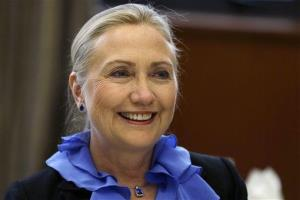 Secretary of State Hillary Rodham Clinton poses for photographs in November.