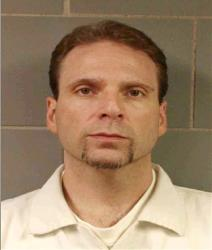 This undated photo provided by the FBI shows Kenneth Conley, one of two inmates who escaped from the Metropolitan  Correctional Center yesterday.