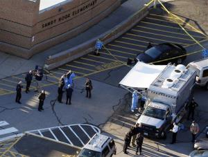 Officials are on the scene outside of Sandy Hook Elementary School where authorities say a gunman opened fire inside an elementary school in a shooting that left 27 people dead.