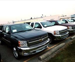 Chevrolet Silverado pickup trucks are seen on a dealer's lot in Troy, Mich., Dec. 17, 2012.