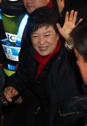 South Korea's president-elect Park Geun-hye of the ruling Saenuri Party waves to supporters as she heads to her office from her house in Seoul, South Korea.