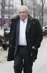 Dominique Strauss-Kahn leaves his apartment building in Paris, Tuesday Dec. 11, 2012.