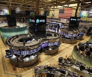In this Oct. 29, 2012 file photo, the floor of the New York Stock Exchange is empty of traders in New York.